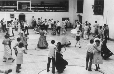Square Dancers from many countries cover gym floor in Cossitt Hall, June 1980