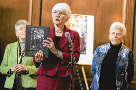 "Marianna McJimsey, center, speaks to an audience during the release party for the book ""The Windows of Grace and St. Stephen's Episcopal Church"" on Sunday."