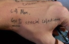Photo of a hand with reminders written on it, including Call Mom and Go to Special Collections