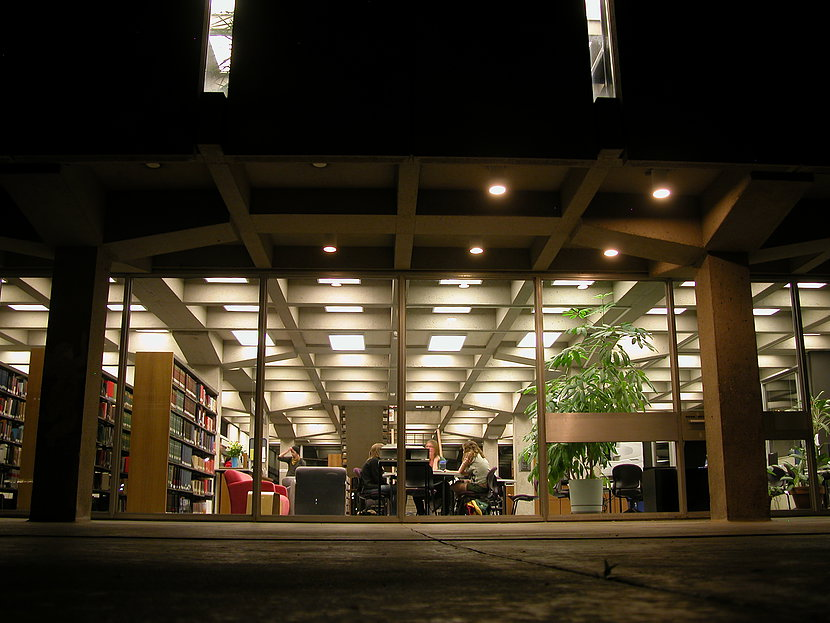 Perhaps Tutt Library shows off its best views at night when the lighted glass-walled main floor creates a sense that the top two massive concrete floors float above.