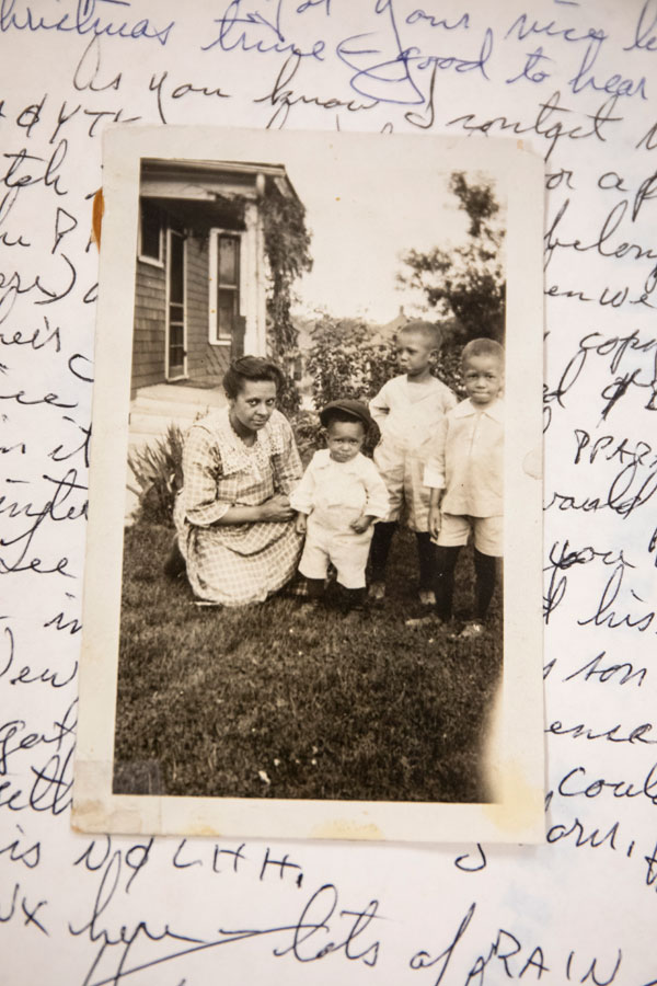 Ellis Butler Jr. along with his mother and brothers